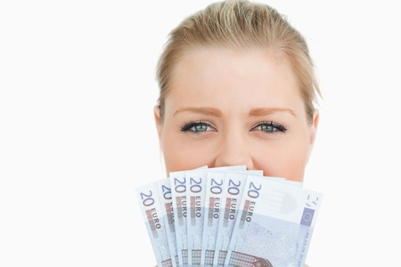 Woman hiding her mouse with her euros banknotes against white background Stock Photo - 16201458