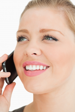 Close up of a pretty woman calling against white background photo