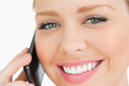 Close up of a woman calling with her smartphone against white background Stock Photo - 16203928