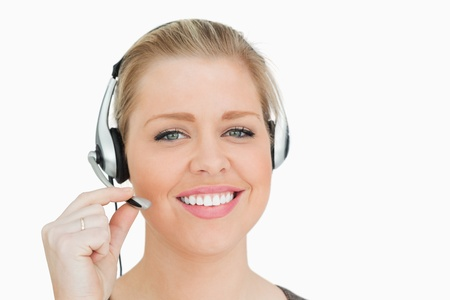 Woman working in a call center against white background photo