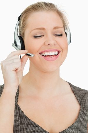 Woman speaking with her headset against white background photo