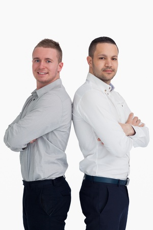 Two men standing back to back against a white background Stock Photo - 16203524