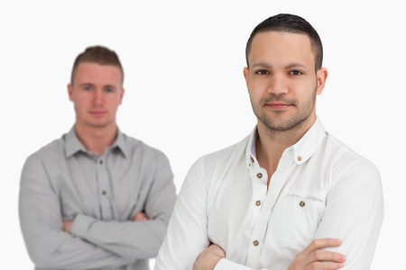 Two men standing while crossing their arms against a white background Stock Photo - 16203209