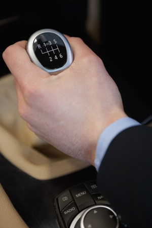 Man using a gear stick in a car dealership Stock Photo - 16208579
