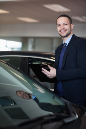 Man holding a notepad in a garage photo