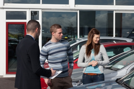 concluding: Man concluding a contract in a dealership Stock Photo
