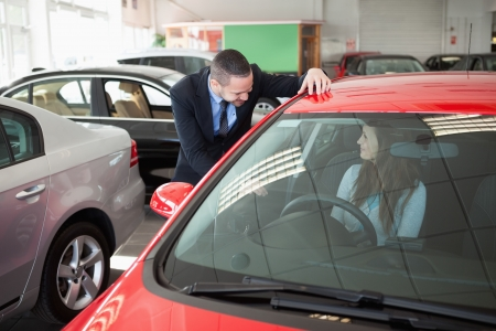 Woman trying a new car in a dealership Stock Photo - 16206842