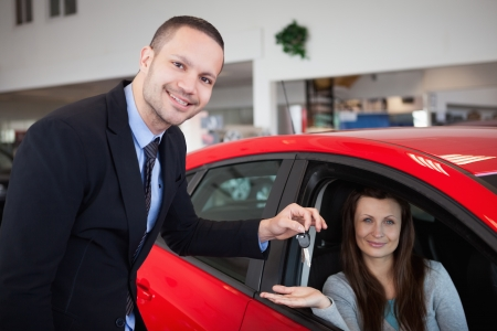 Client being inside the car in a dealership photo