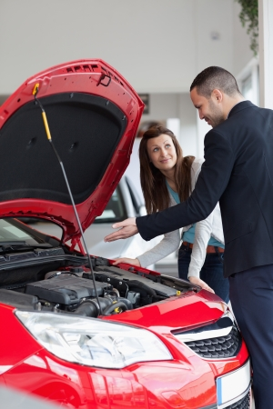 Dealer showing the car engine in a garage Stock Photo - 16207952