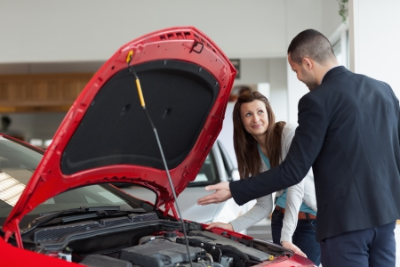 Man showing the car engine in a garage Stock Photo - 16207834