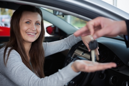 happy client: Happy client receiving car keys in a garage