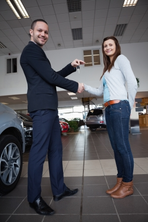 Man shaking hand with woman in a garage photo