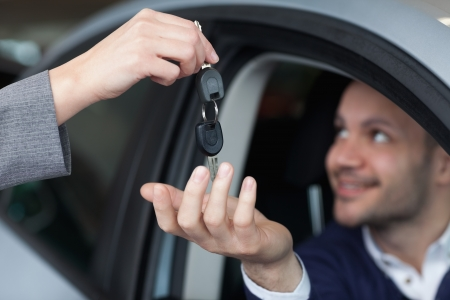 Man receiving car keys in his car Stock Photo - 16206777