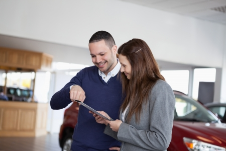 Man showing a file in a dealership Stock Photo - 16207629