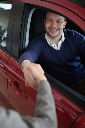 Man shaking hand of a woman in a car Stock Photo - 16208956