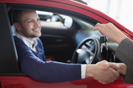 Client shaking hand to a woman in a garage Stock Photo - 16208913