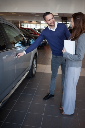 Man holding car handle in a dealership Stock Photo - 16208969