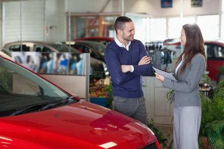 Man speaking to a businesswoman in a garage Stock Photo - 16208857