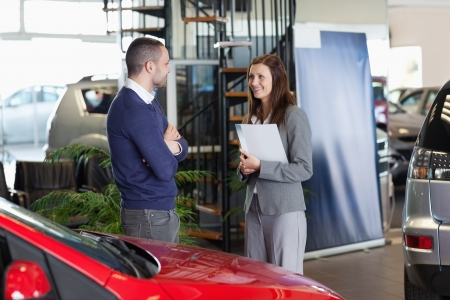 Man speaking to a woman in a dealership Stock Photo - 16208530