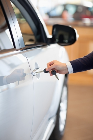 Man inserting a car key in the lock in a garage photo