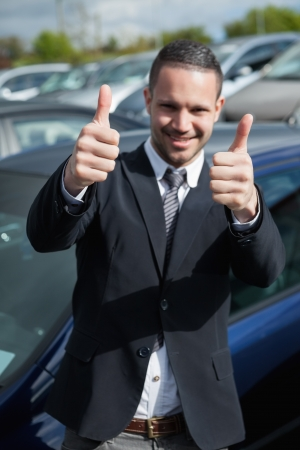 Happy man raising his thumbs outdoors Stock Photo - 16206908