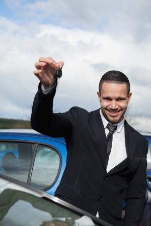 Happy man holding car keys outdoors Stock Photo - 16204748