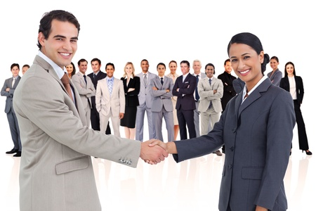 Business people shaking hands against a white background photo