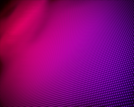 Background of multiple purple dots fading to magenta photo