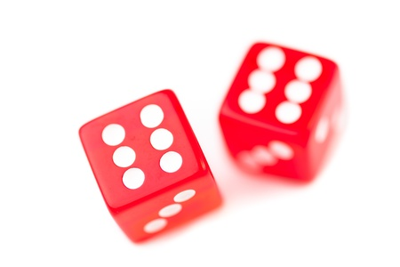 Two red dices in motion against a white background photo