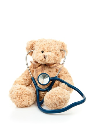 Teddy bear with a stethoscope against a white background