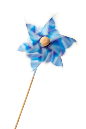 Pinwheel in motion against a white background photo