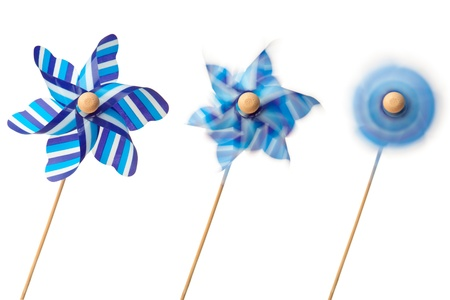 Three blue pinwheels against a white background photo