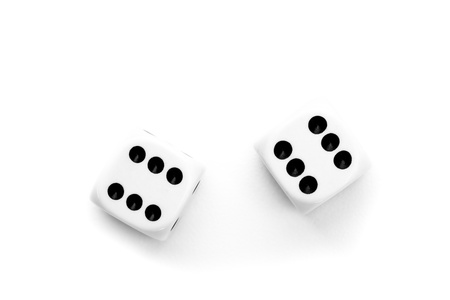 double the chances: Black and white dices against a white background