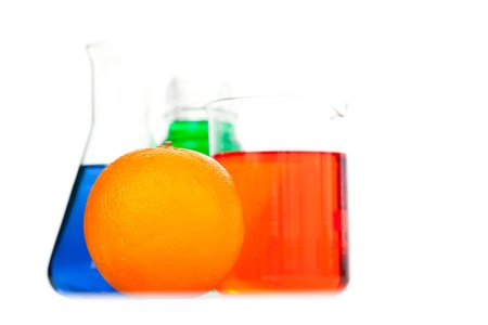 Orange next to beakers against a white background Stock Photo - 16198560