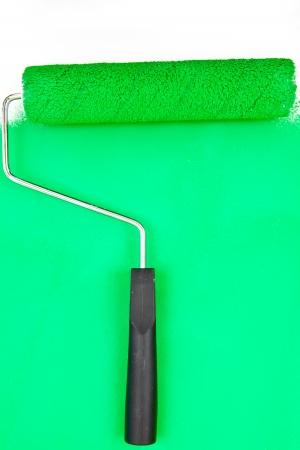 brush stroke: Green brush stroke with paint roller in a studio