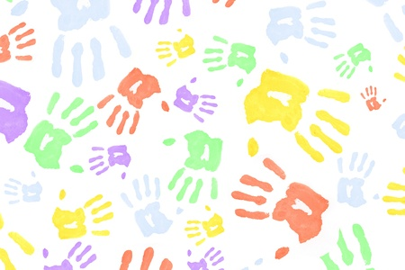 handprints: Multi colored handprints against a white background Stock Photo