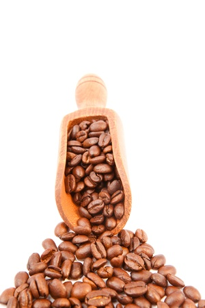 Wooden shovel filled of coffee beans against a white background Stock Photo - 16201758