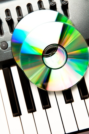 Close up of a compact disc on a grey synth photo