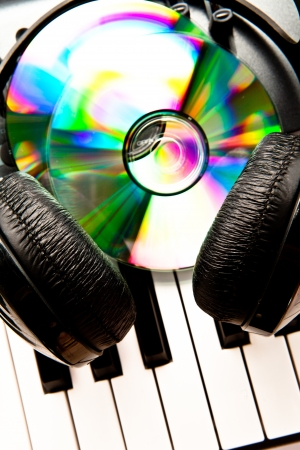 Close up of a headphone and cd on a synth Stock Photo - 16208042