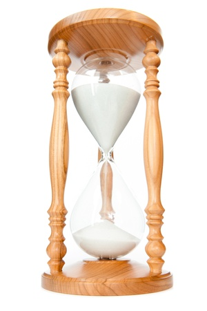 elapsed: Sand flowed of hourglass against a white background