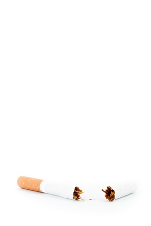 pernicious: Close up of a cigarette broken against a white background