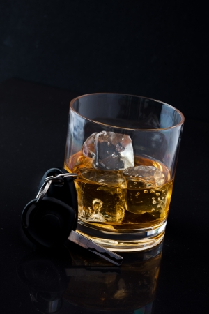 Whiskey on the rocks and car key against a black background Stock Photo - 16205194