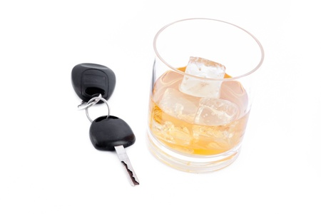 Car key and a whiskey against a white background Stock Photo - 16199254