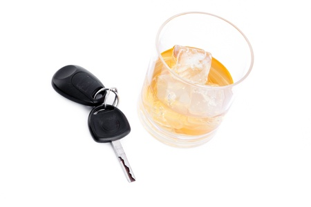 Car key next to a whiskey against a white background Stock Photo - 16198718