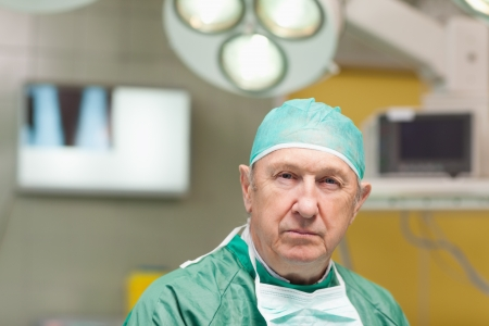 operation gown: Portrait of a surgeon in a surgery room
