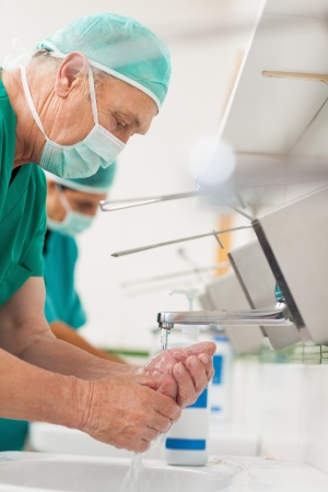 hygiene: Surgeons washing their hands in a sink Stock Photo