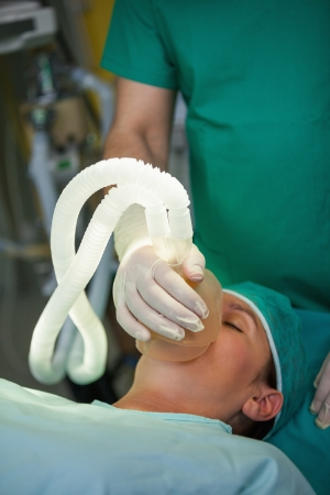 Sleeping patient with a mask on her face in a surgical room Stock Photo - 16208540