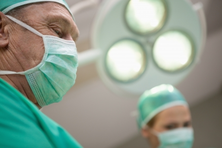 surgical light: Two surgeon standing under a surgical light in a surgical light