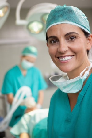 Woman surgeon smiling in a surgical room photo