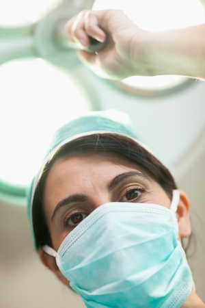 Woman surgeon holding a surgical lighting in a surgical room Stock Photo - 16203931